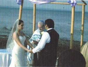 http://jewish.server272.com/wp-content/uploads/2012/01/RABBI+ARTHUR+SEGAL+OFFICIATING+AT+BEACH+WEDDING+HILTON+HEAD+ISLAND+SC-781513.jpg